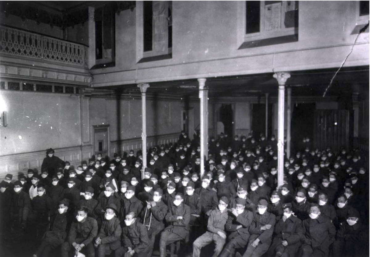 U. S. Army Hospital Number 30, Royat, France: Patients at moving picture show wearing masks because of an influenza epidemic, ca. 1918 http://resource.nlm.nih.gov/101396929
